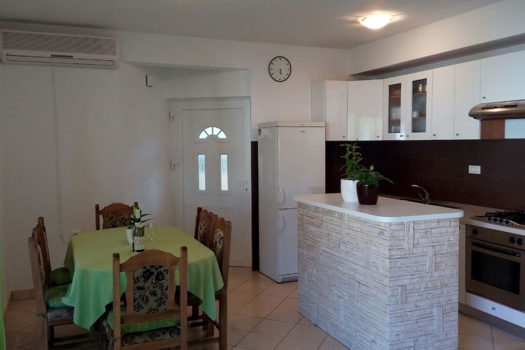 Dinning room and fully equipped kitchen