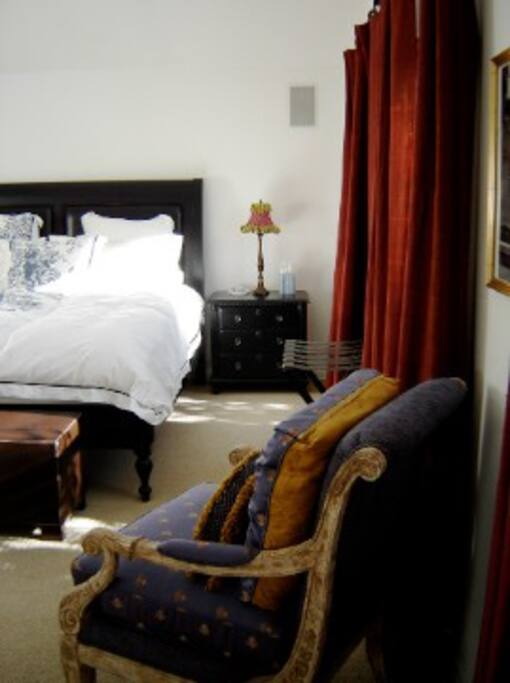 Guest Suite with leather-upholsted king bed