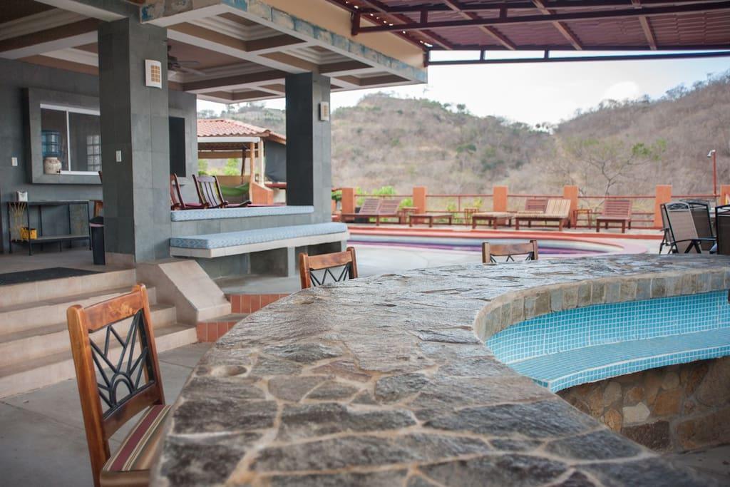 Flagstone Custom Bar overlooking the ocean & Pool  Deck- Great for Sunsets