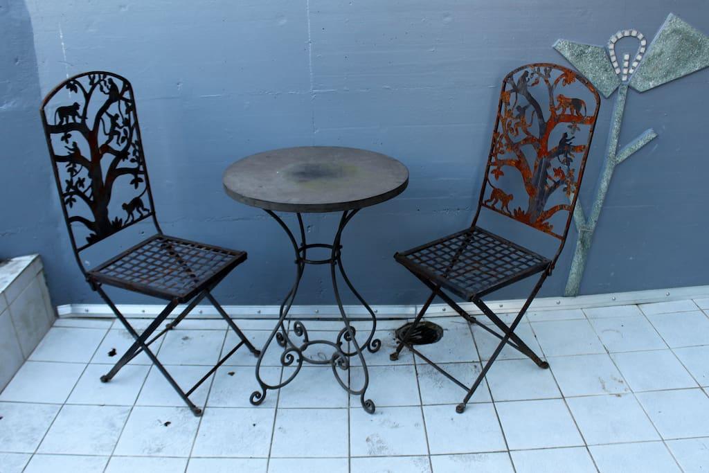 entrance of the house.. a couple of rusty Jugendstil chairs.. (the t-shirt is not yet available)