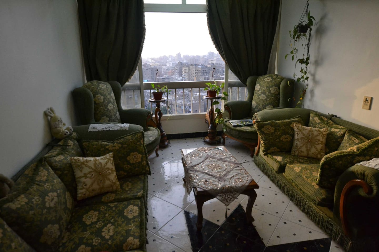 Living room over the top of Cairo with  pyramids view