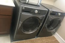 Laundry Room with brand new washer and dryer ready for guests in case if they need.