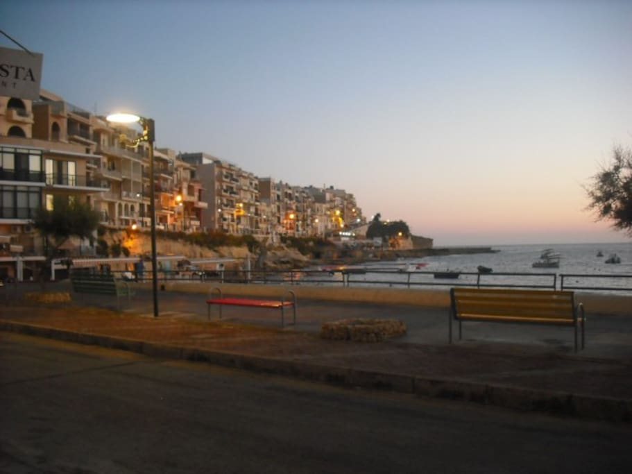 Sunset at Marsalforn.  Promenade with many restaurants and wine bars