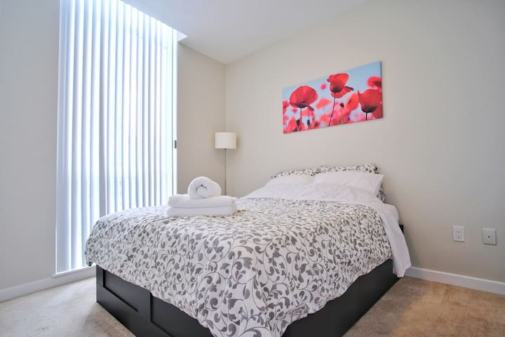 Master bedroom with queen sized beds