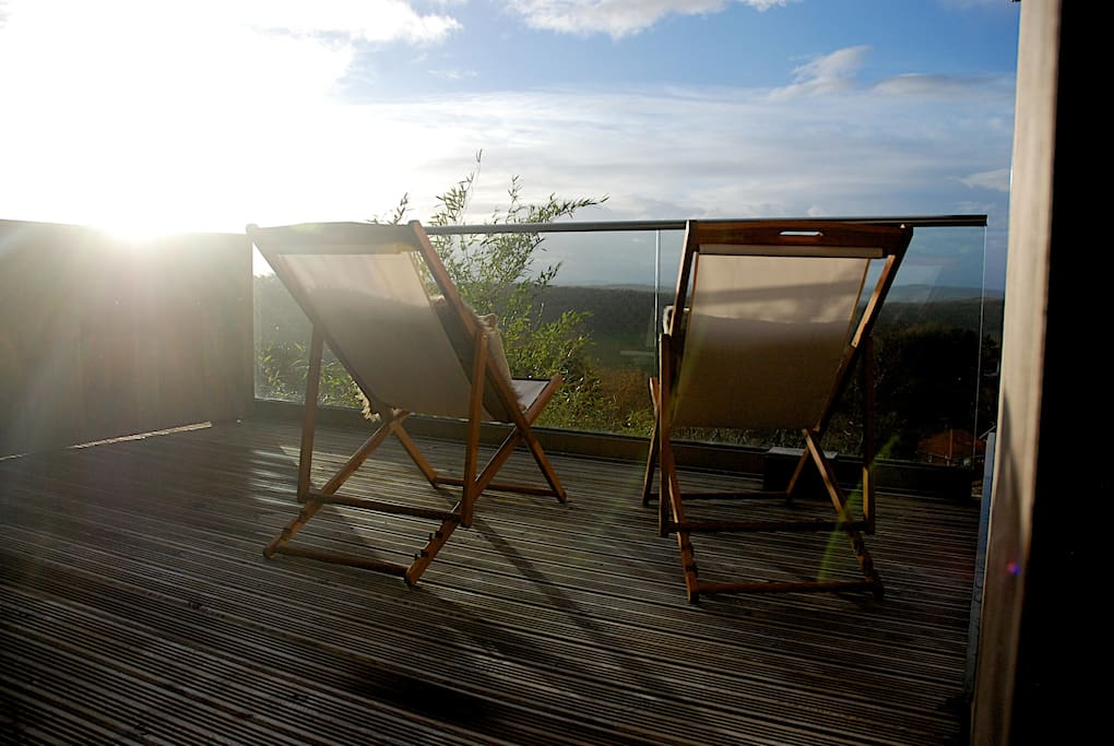 Patio doors lead onto a private balcony - the perfect place to watch the sun set.