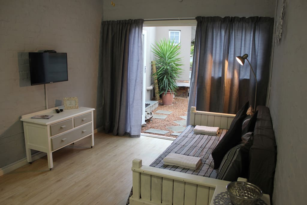 Lounge area with flat screen & full DSTV - additional sleeping for 2 children