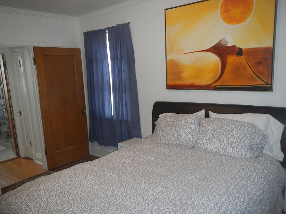 Queen size bed with down comforter
