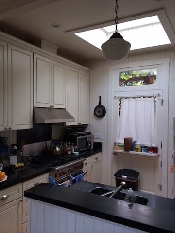 New chef's kitchen with a double dishwasher & Wolf Range.