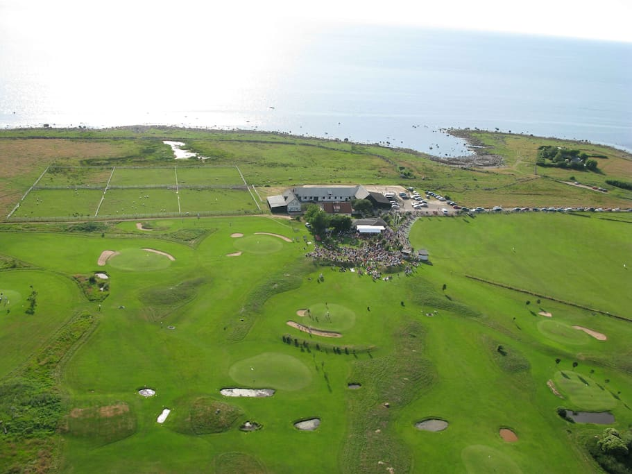 The accommodation and the golf course from the air
