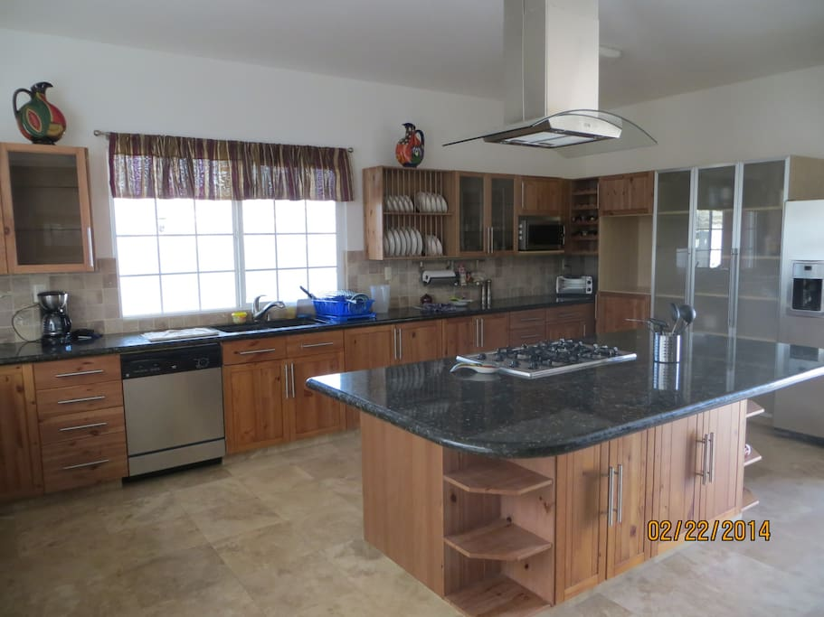 Large fully equipped kitchen is perfect for gathering and sharing the events of the day!