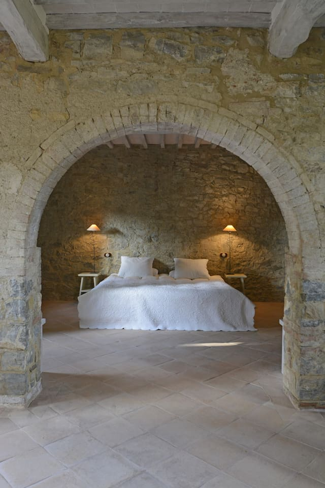 A Medieval arch separates bedroom and living room.