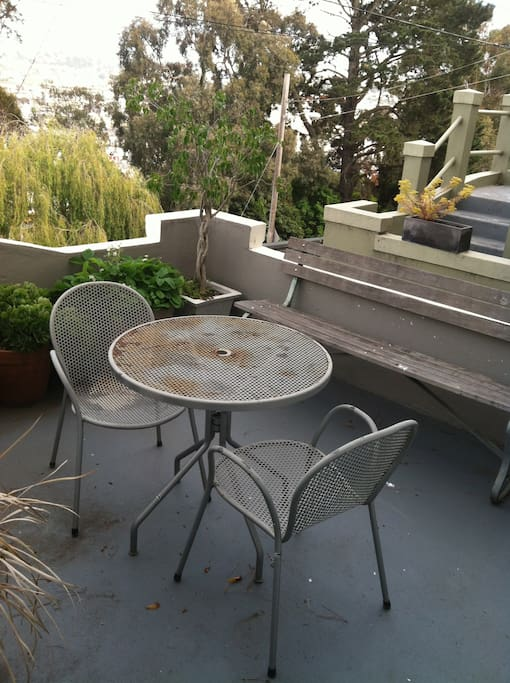 The seating area on the front porch.  It gets great morning light and looks out across San Francisco Bay.