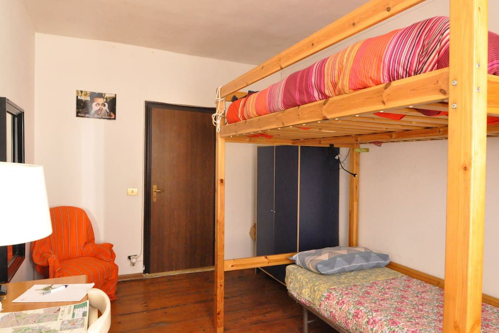The bedroom with a double bunk bed and a single bed underneath