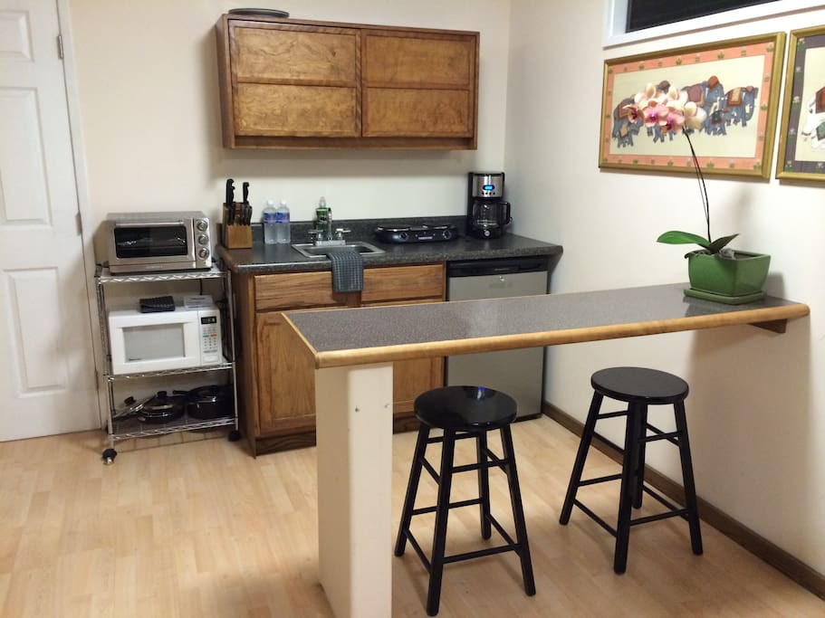 Kitchen with mini fridge, burner, microwave, coffee maker and toaster oven. With dishes and pots and pans!