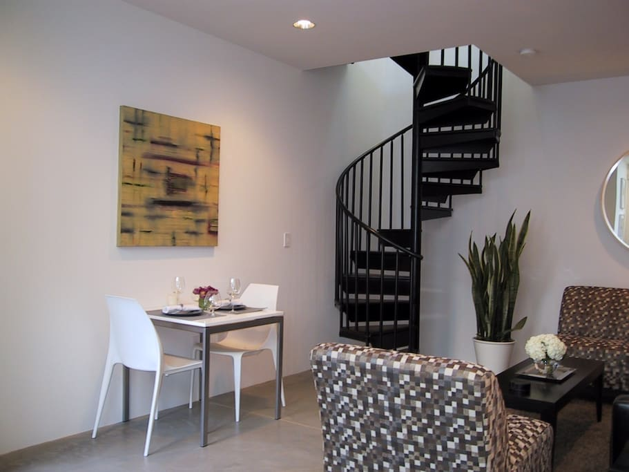 Living - Dining Area with Spiral Staircase to Bedroom / Bath
