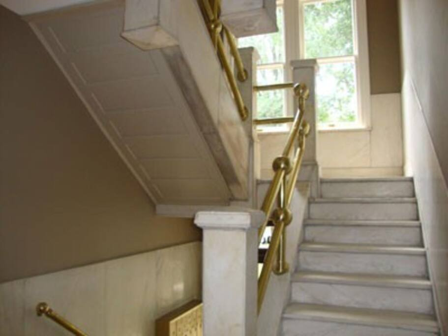 The renovation maintained the historic elements, such as a marble foyer and steps and brass railings.