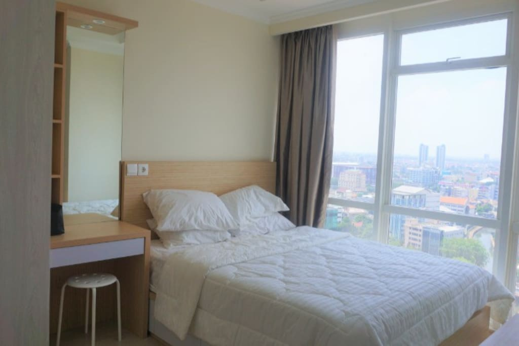 You have a very comfy bed to sleep on after a busy day in Jakarta