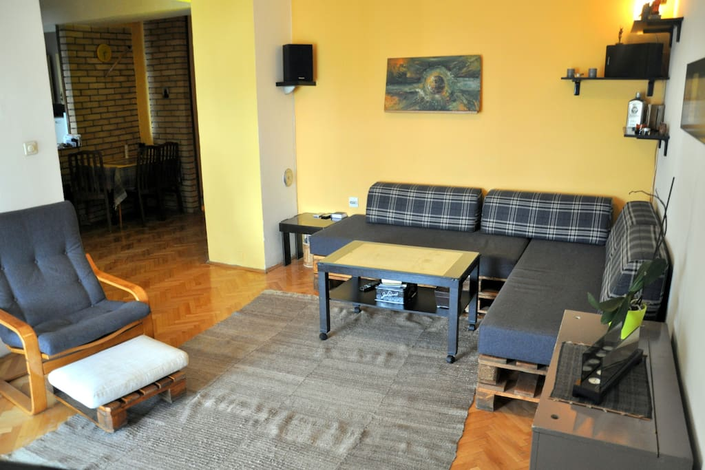 Living room with digital TV, big screen  LED TV and surround  system, club table sofa and relax chair.