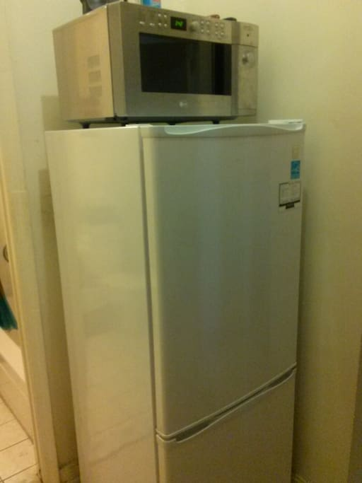 Microwave and toaster are above the refrigerator, and are accessible right outside of your room.