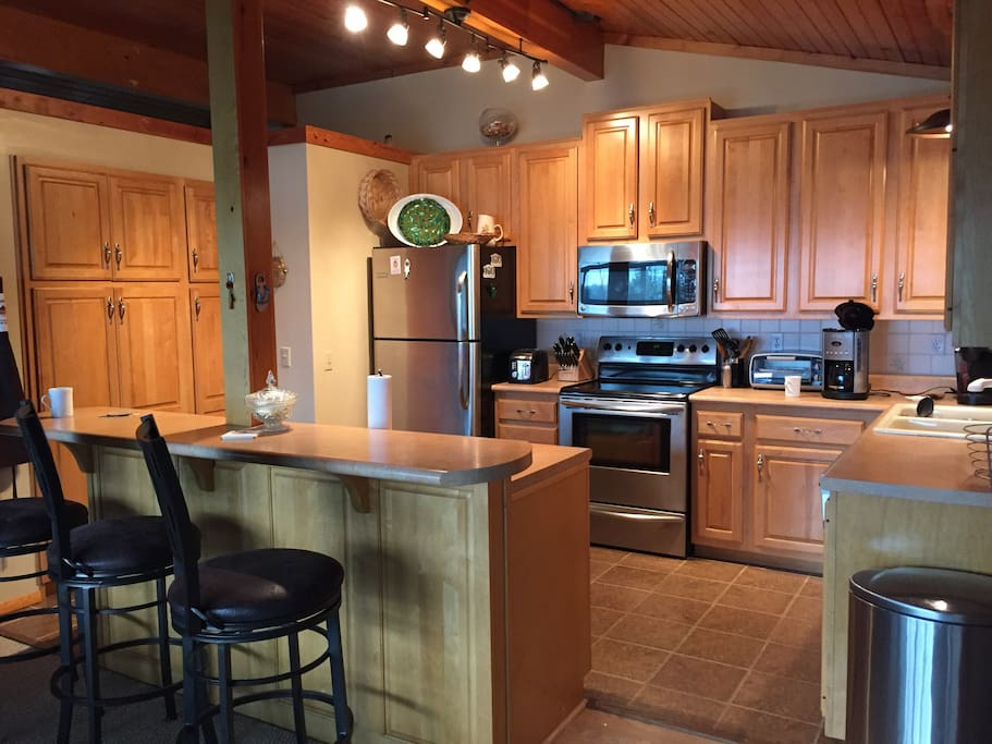 Fully loaded kitchen with stainless steel appliances.