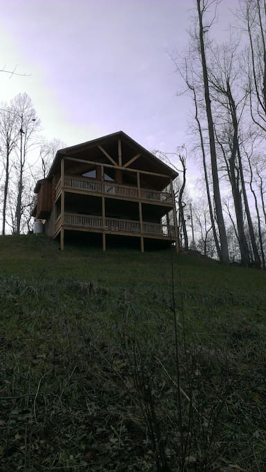 Exterior view of cabin from mountainside