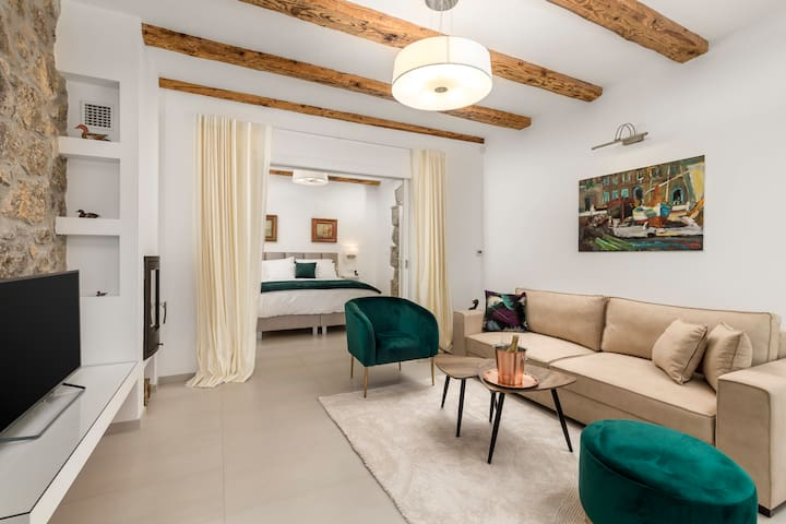 Living room with bedroom. Floorheating at your disposal in the entire facility including bathroom,  sauna, kitchen and dining room (veranda)