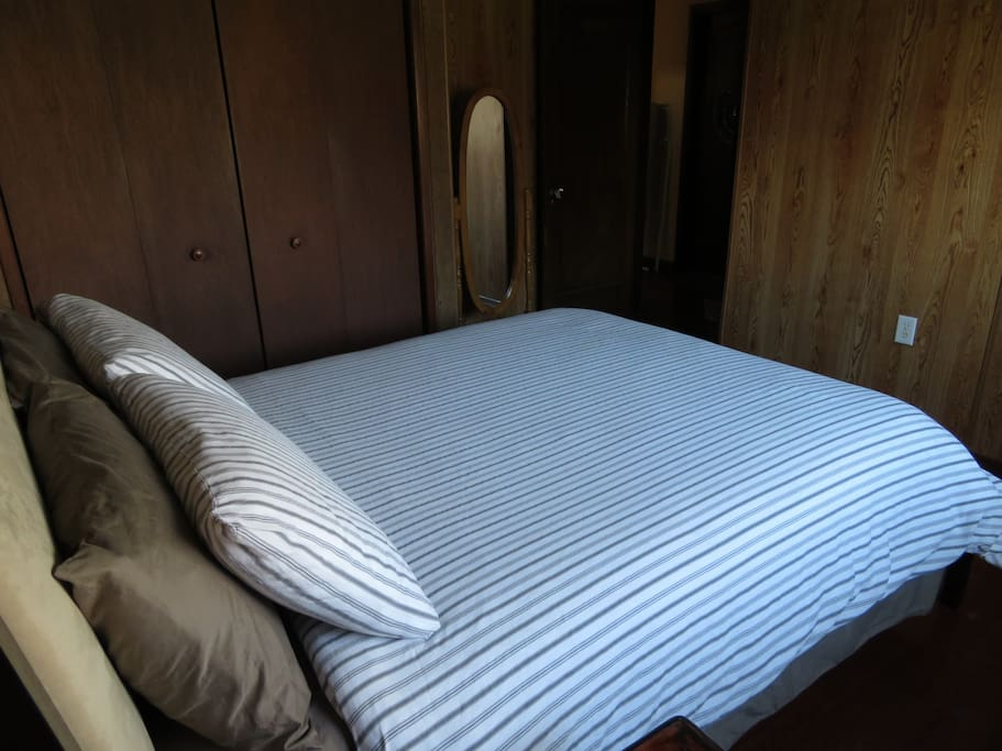 Bed has a comfortable mattress pad and pillow covers. All linens are washed with hypoallergenic lavender detergent.