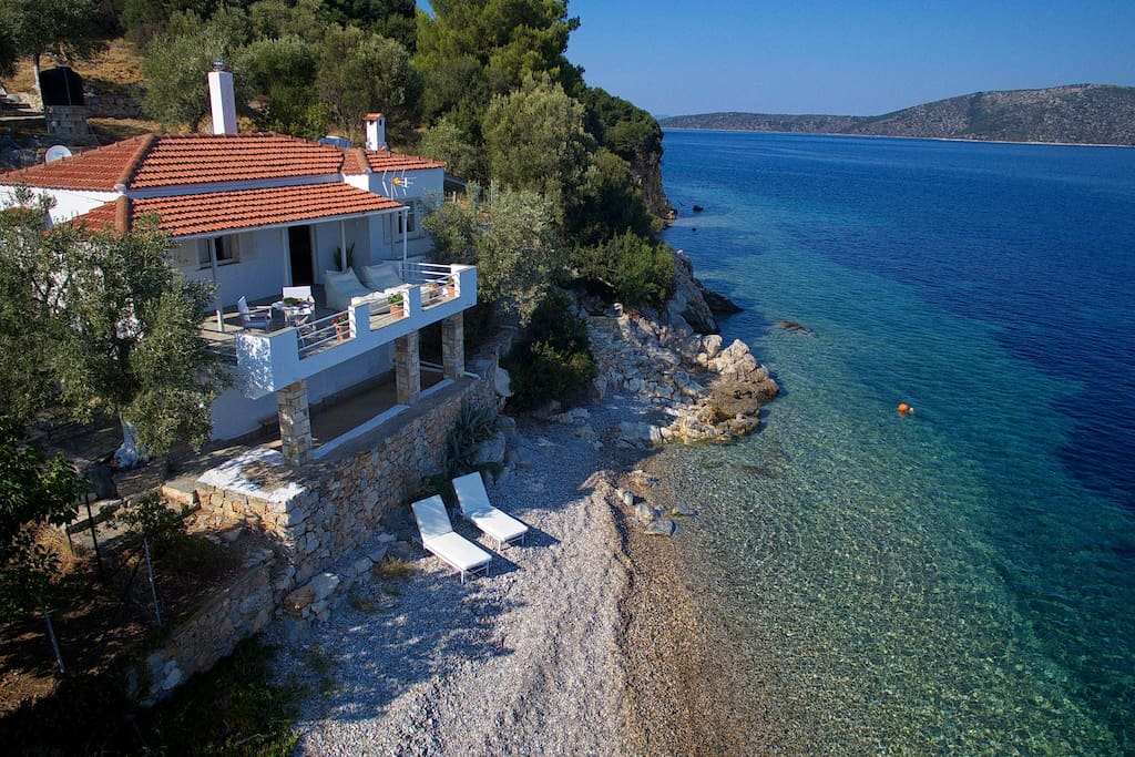 Sunbeds on the beach , steps down the side of the villa