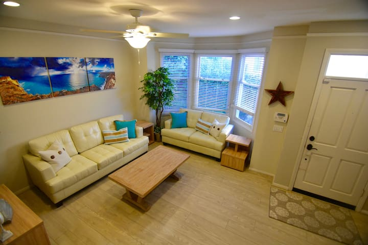 Beautifully decorated living room with pull-out sleeper couch.