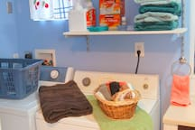 Full bathroom downstairs with washer and dryer, complimentary laundry soap, plenty of linens.