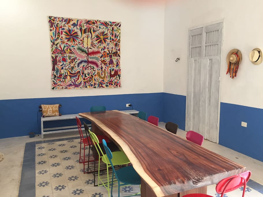 View toward the dining room. Enjoy the 10-foot 'live edge' table, Mexican textiles and schoolchairs in the comfortable dining room.