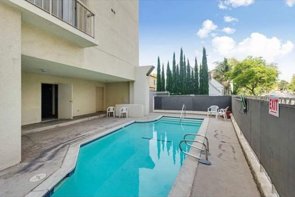 The condo includes access to a small communal swimming pool.