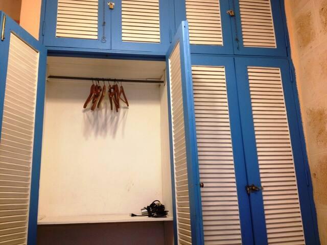 Closet with iron and hairdryer / Armario con plancha y secador de pelo.