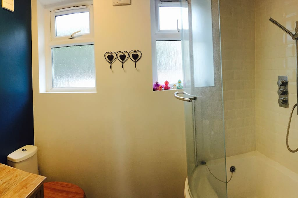 bathroom complete with built in shower and bath