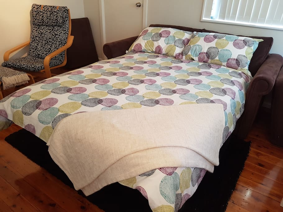 Sofa bed with immaculate innersprung mattress and woolen underlay. Very comfortable for a great night's sleep.