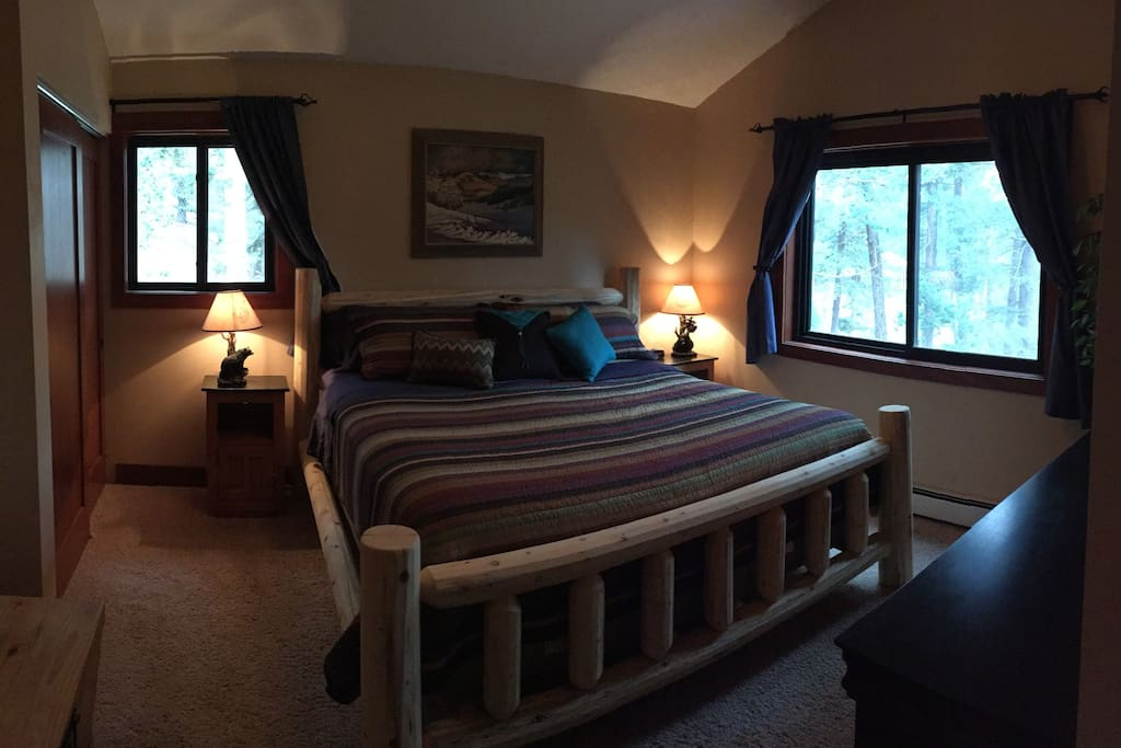 Master bedroom. Large king size bed with an attached master bathroom. Enjoys a little bear charm is well.