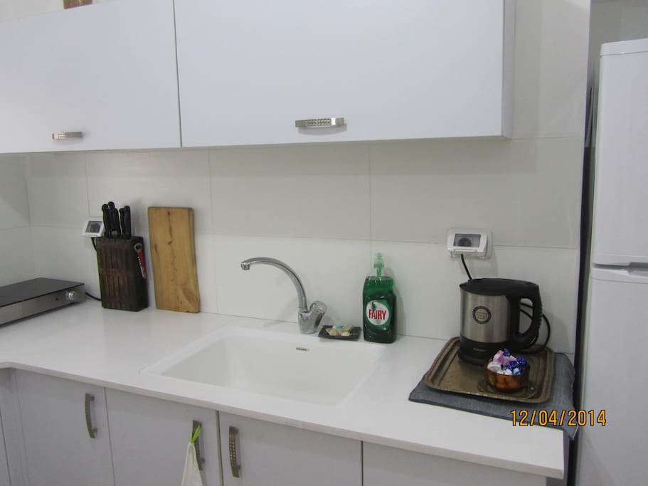 Whit Marble and white sink  in kitchen