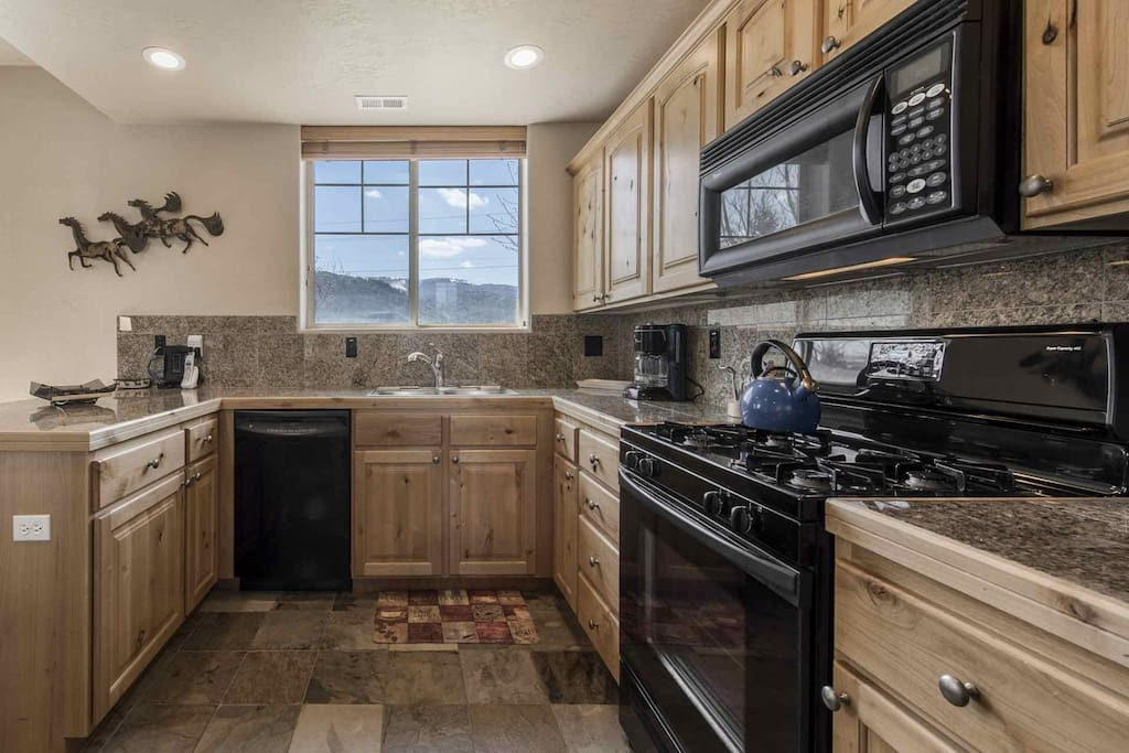 Cooks will love the granite countertop, oak cabinetry, new appliances including a gas stove and numerous small household appliances.