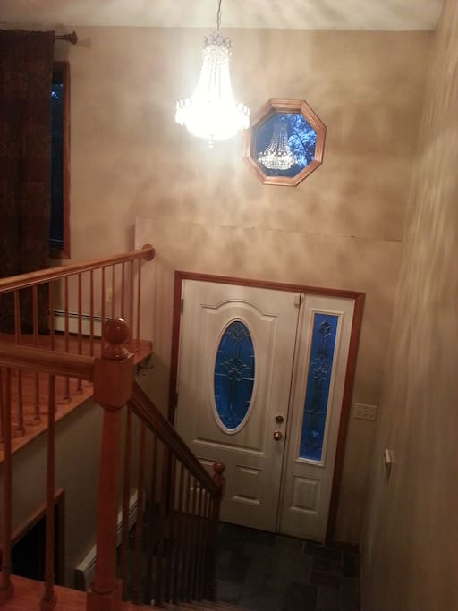 Entryway with chandelier.