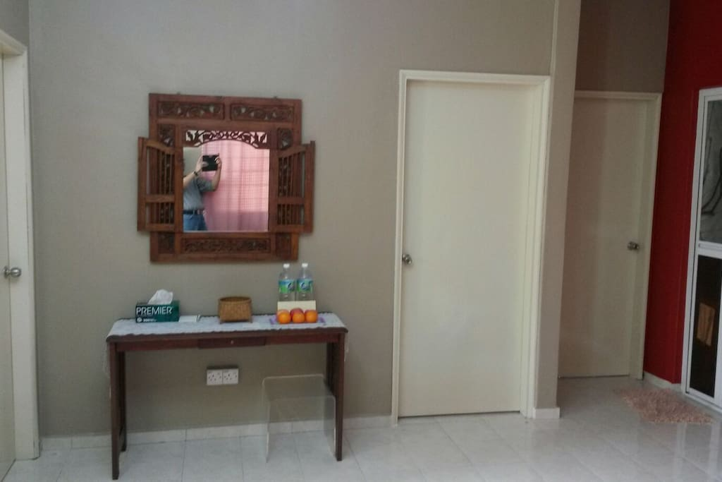 Entrance to 3 bedrooms fully air conditioned with ceiling fan come  with Queen size bed, wardrobe, table lamp, side table and mirror in each room.