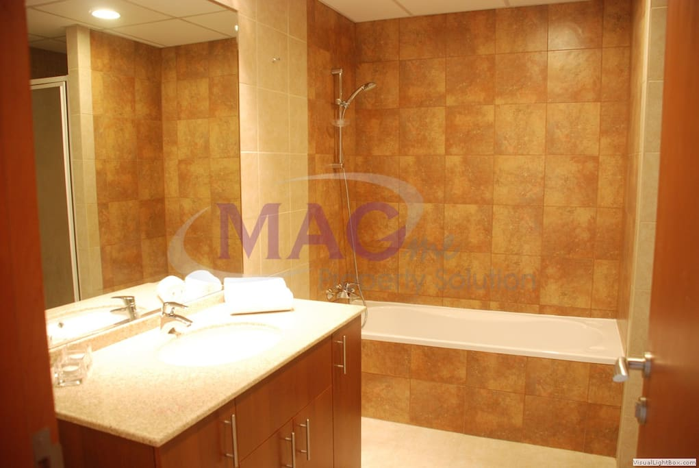 The bathroom with bath and separate shower
