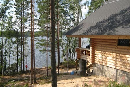 Log Cabin beside lake and forest