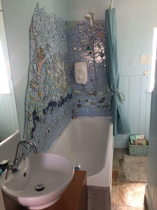 Bathroom with mosaic art