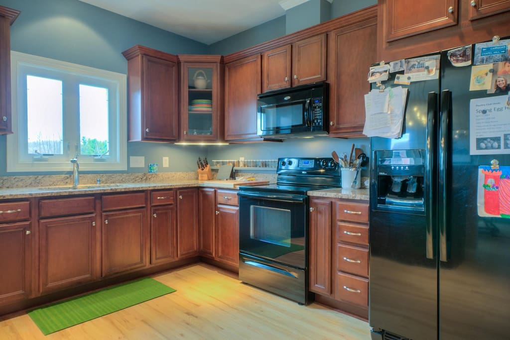 Large kitchen, granite counter tops.
