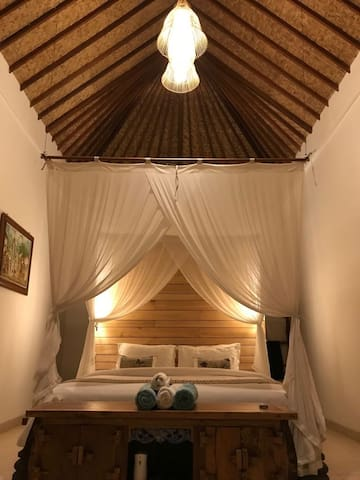 Bedroom #2 upstairs with king-sized bed, private balcony overlooking pool and jungle, private bathroom, A/C and day bed.