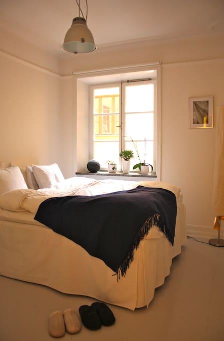 Bright quiet bedroom facing the courtyard.