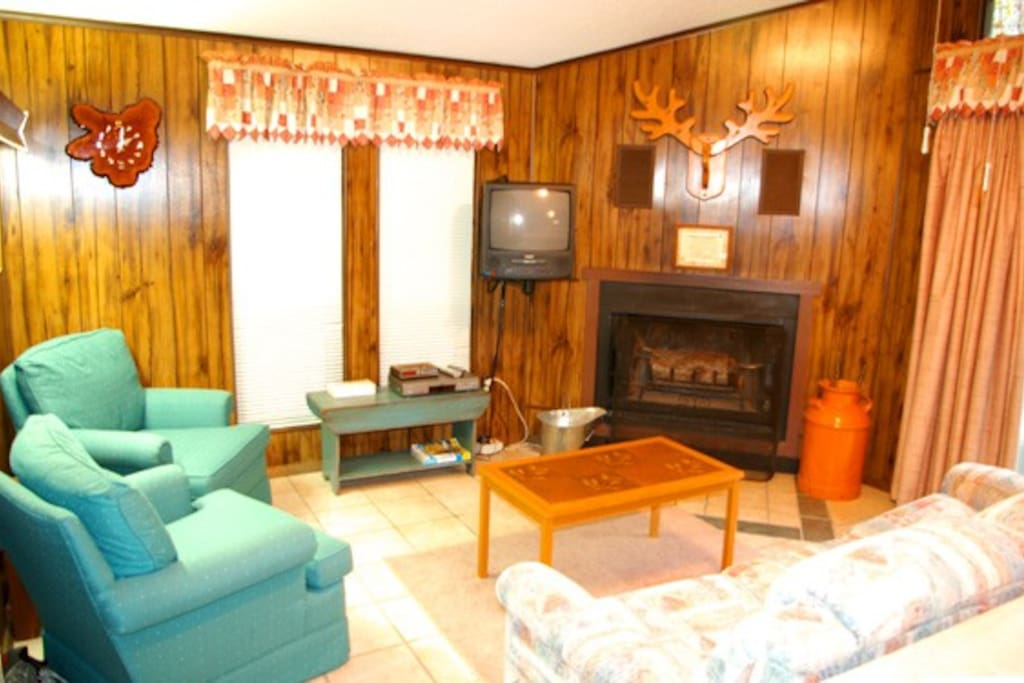 The comfortable living space features the wood burning fireplace and TV with cable television & DVD player.
