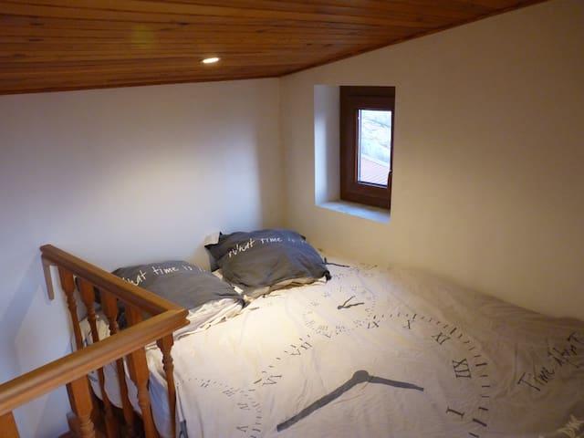 Le lit dans la partie haute du duplex