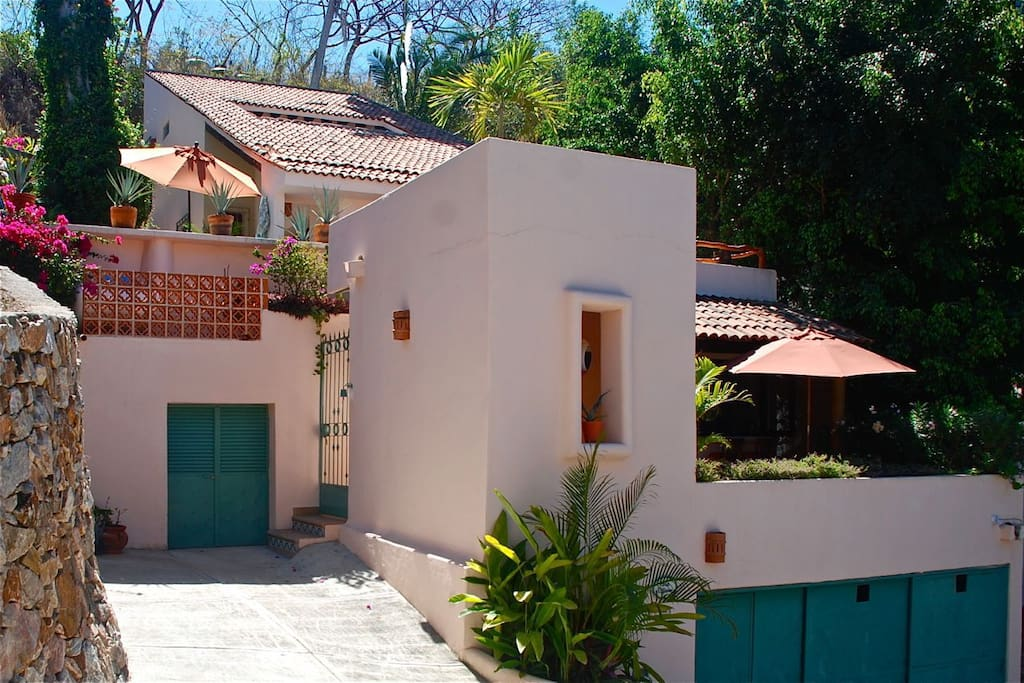Exterior of house showing casita terrace on the lower level.