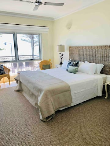Master bedroom with wall mounted TV, walk-in robe, desk, balcony and amazing views. A great place to have some time out if staying with a group.